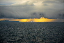 Sunset And Shelf Cloud With A Lighthouse