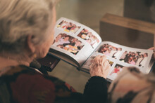 Old Woman With Photo Album