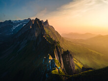 Schaefler Switzerland, A Couple Walking Hiking In Mountains During Sunset, Man And Woman Sunset At The Ridge Of The Majestic Schaefler Peak In The Alpstein Mountain Range Appenzell,