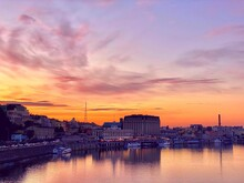Beautiful Sunset Over Dnieper River At Autumn Night . Evening Kiev Town View. Beautiful Cityscape Of Kyiv City At Night. Urban Skyline At Dusk. View Of The Embankment And River Port.