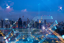 Information Flow Hologram, Night Panorama City View Of Kuala Lumpur. KL Is The Largest Technological Center In Malaysia, Asia. The Concept Of Programming Science. Double Exposure.