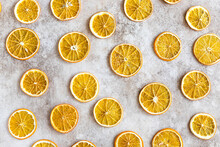 Pattern With Slices Of Dried Orange On Light Concrete Background. Food Background. Top View. Flat Lay.