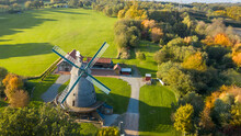 Aerial Drone Beautiful View On Old Traditional Windmill In Middle Autumn. Germany  Rural Landscape In Sunny Evening.