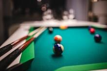 Billiard Balls On Green Table With Billiard Cue