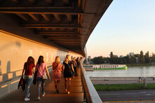 People Walking On The Bridge