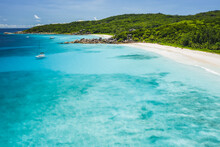 Aerial Drone View Of Tropical Paradise Like Beach With Pure Crystal Clear Turquoise Water, Bizarre Granite Rocks And Coconut Palm Trees. Travel Concept