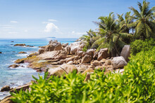 La Digue, Seychelles. Tropical Exotic Paradise Like Beach With Granite Boulders And Coconut Palm Trees
