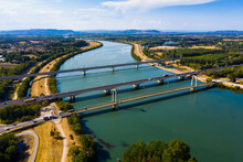 Picturesque Aerial View Of Rhone River With Three Bridges Near Small Town Roquemaure In Gard Department Of Southern France