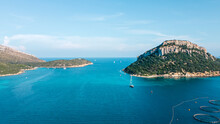 View From Galf Aranci, On The Open Mediterranean Sea, In Front Of It Another Island. In The Water Are Several Boats On The Way And A Fish Farm Is To Be Seen. Drone Aerial View, North Sardinia, Italy.