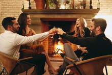Four Friends Making A Toast In A Luxury Hotel