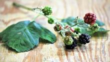Blackberries On Wooden Table