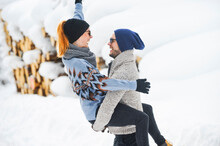 Happy Couple Enjoying During Snow In Winter