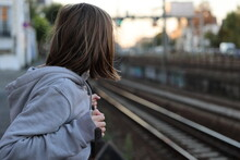 Girl Watching A Railway In France At Sunset