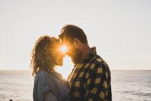 Bearded Man Romancing With Girlfriend At Beach
