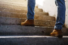 Close Up Of Man Walking Up On Concrete Staircase