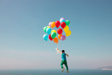 Boy Flying With Bunch Of Balloons In Sky