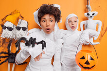 Shocked Scared Mother And Daughter Notice Horrible Scene Dressed Like Halloween Ghosts Holds Creepy Spider And Carved Pumpkin Cannot Believe Own Eyes Prepares For Celebration Of Mysterious Holiday