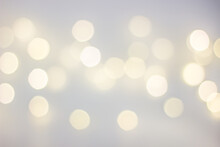 White Background With Warm Yellow Round Bokeh. Copyspace. New Year's Holiday Lights. Christmas.