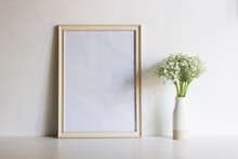 A White Photo Frame With White Flowers With Nature Light.