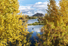 Beautiful View Of A Lake Through The Trees With Yellow Foliage
