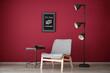 Leinwandbild Motiv Stylish design of living room with modern armchair near color wall