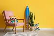 Leinwandbild Motiv Armchair in room with stylish decor near color wall