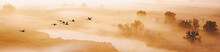 Autumn Landscape - A Flock Of Swans Flies In The Morning Fog Over The River Valley, Panorama, Banner
