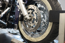 Front Motorcycle Wheel With Shiny Brake Disc Closeup