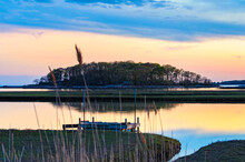 Tidal Marsh At Sunset, Niantic Connecticut With View Of Dock And Watts Island At Sunset, Blue Hour. Golden Hour Sky With Trees And Island In Silhouette.