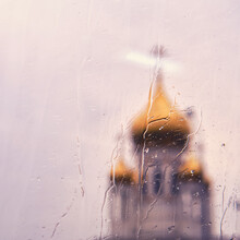 Blurred Background Of Church Domes Through Glass With Water Drops From Rain, Bokeh