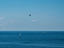 Kite Surfing On The Sea At Sunny Day
