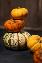 Pumpkins Balancing Vertically On Table, Many Little Pumpkins Different Colors, Concept Of Thanksgiving Day Or Symbols Of Halloween