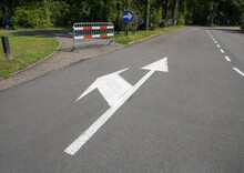 Road Sign, Lane Markings - Straight Ahead And Turn To The Left Closed By A Fence