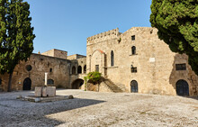 Argyrokastrou - Square Of Jewish Martyrs In The Old Town Of Rhodes, Dodecanese, Greece; Detail With Stairs, Tree And Sea Horse Fountain; Medieval Buildings Within The Walls Of The Old Part Of Rhodes