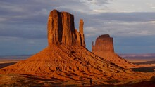 Monument Vally,Mitten At Sunset.Red. Monument Valley On The American Indian Reservation.From Left: West Mitten Butte And East Mitten Butte In The Sunset.