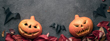 Two Jack Pumpkin Heads Are Scary, Halloween, Panaramic Photography. Autumn Holiday Leaves