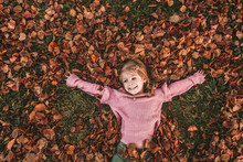 Jumping Into A Pile Of Fall Leaves