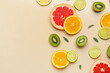 Leinwandbild Motiv Slices of different fruits on color background