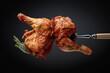 Leinwandbild Motiv Hot chicken drumsticks on a fork.