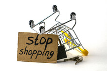 The Concept Of Refusing To Buy A Reasonable Consumption Is An Inverted Shopping Basket With A Padlock X Keys And A Sign With The Inscription Stop Shoppingp Shopping On A White Background