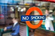 LONDON, UK - JULY 2ND, 2015: Non Smoking Sign On A City Window.