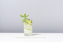 Refreshing Cocktail With Lime And Cucumber Served On White Table