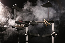 Modern Electronic Drum Kit And Smoke On Dark Background. Musical Instrument