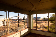 View Of The Old Train Station Through The Broken Windows Of The Abandoned Railway Town Called Putsonderwater, Ghost Town In South Africa.