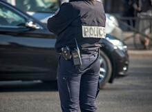 An Equipped Policewoman In Paris Regulates Traffic.