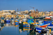 Malta, Marsaxlokk, Fishing Town Port With Traditional Luzzu Boats