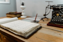 Old Book And Typewriter On Desk