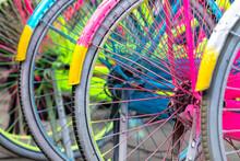 Close-Up Of Multi Coloured Bike Wheels At A Bike Stand, Indonesia