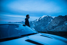 Young Man With Sportscar, Taking A Break At Stelvio Pass, Italy