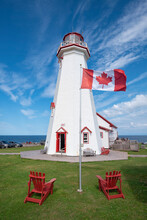 Canada, Prince Edward Island, Elmira, Canadian Flag In Front Of East Point Lighthouse